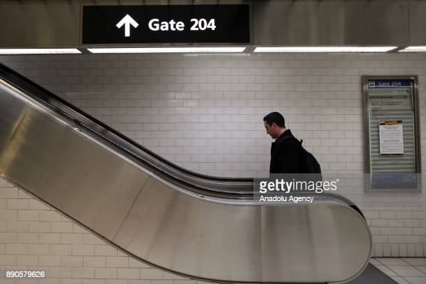 A traveler takes an escalator at New York Port Authority after it was reopened following an explosion in Manhattan borough of New York City United...