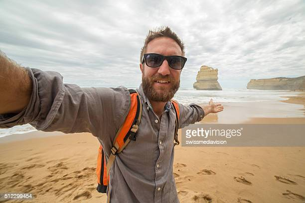 Traveler takes selfie portrait on Gibsons steps beach-Great ocean road