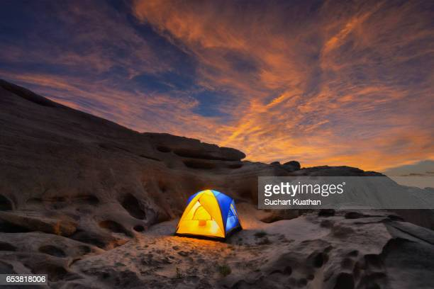 Traveler tent under the sunset sky