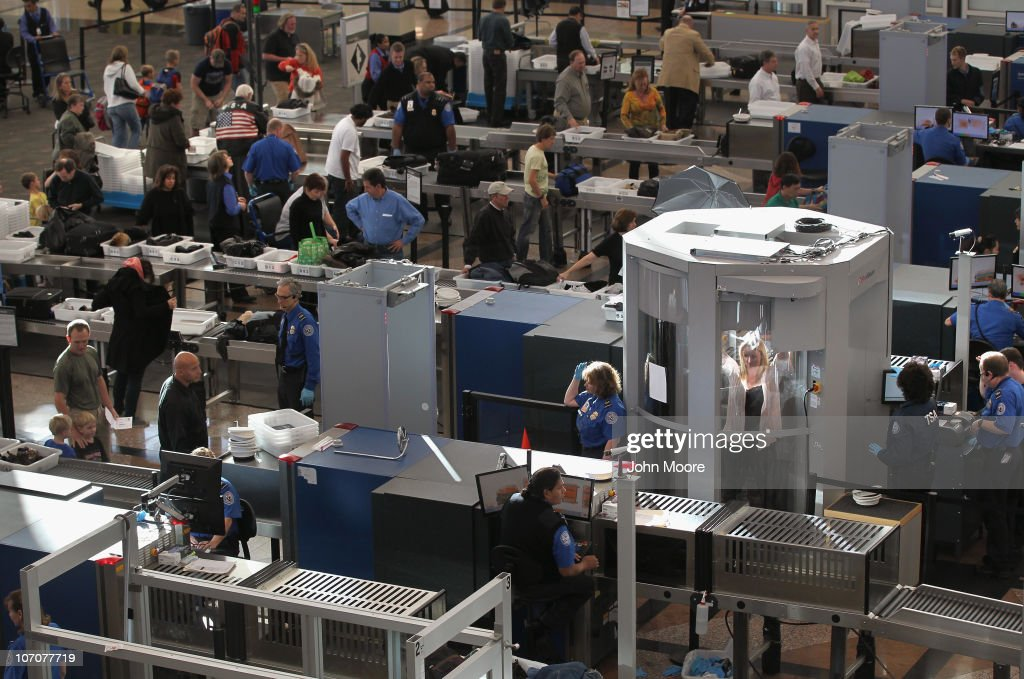 A traveler undergoes a full body scan performed by Transportation Security Administration agents as she and others pass through the security checkpoint at the Denver International Airport on November 22, 2010 in Denver, Colorado. The TSA is bracing for heavy traffic the day before Thanksgiving, as two separate internet campaigns are promoting a 'National Opt-Out Day' protest during which travelers are urged to 'opt out' of the new body scanners because of concerns over privacy and possible exposure to radiation. Those passengers who refuse the scans must instead undergo an enhanced pat down by TSA agents, which could further slow down security lines on the busiest air travel day of the year.