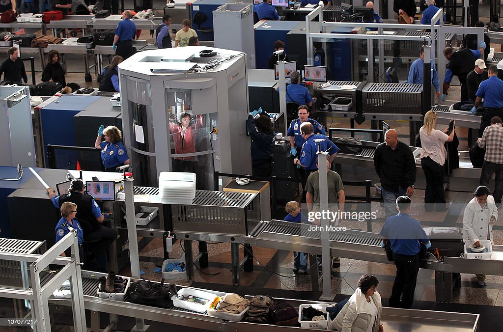 A traveler undergoes a full body scan performed by Transportation Security Administration agents at the Denver International Airport on November 22, 2010 in Denver, Colorado. The TSA is bracing for heavy traffic before the Thanksgiving holiday, as two separate internet campaigns are promoting a 'National Opt-Out Day' protest during which travelers are urged to refuse the new body scanners because of concerns over privacy and possible exposure to radiation. Those passengers who refuse the scans must instead undergo an enhanced pat down by TSA agents, which could further slow down security lines on the busiest air travel day of the year.