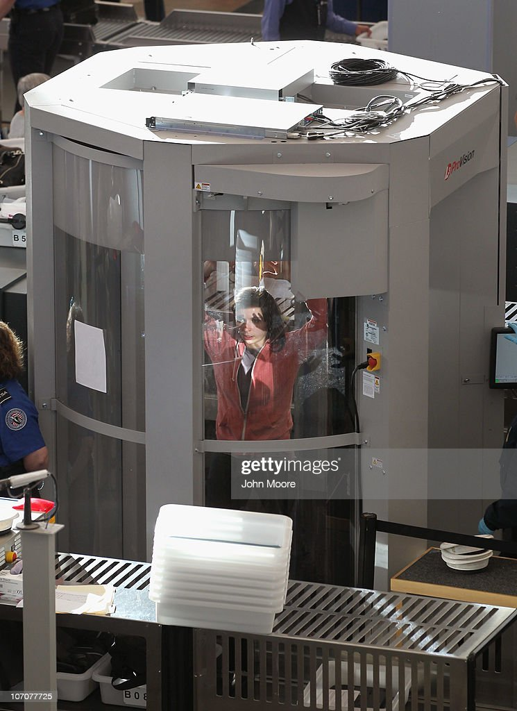 A traveler undergoes a full body scan performed by Transportation Security Administration agents at the Denver International Airport on November 22, 2010 in Denver, Colorado. The TSA is bracing for heavy traffic the day before Thanksgiving, as two separate internet campaigns are promoting a 'National Opt-Out Day' protest during which travelers are urged to 'opt out' of the new body scanners because of concerns over privacy and possible exposure to radiation. Those passengers who refuse the scans must instead undergo an enhanced pat down by TSA agents, which could further slow down security lines on the busiest air travel day of the year.