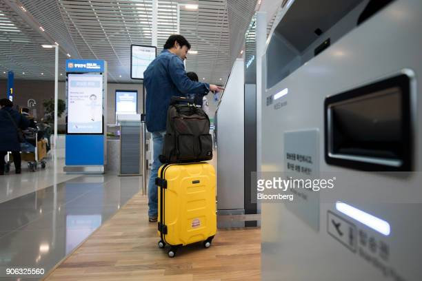 A traveler uses a self checkin kiosk inside the terminal 2 building at Incheon International Airport in Incheon South Korea on Thursday Jan 18 2018...