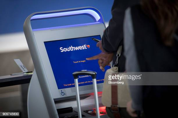 A traveler uses a Southwest Airlines Co self checkin kiosk at Oakland International Airport in Oakland California US on Friday Jan 19 2018 Southwest...