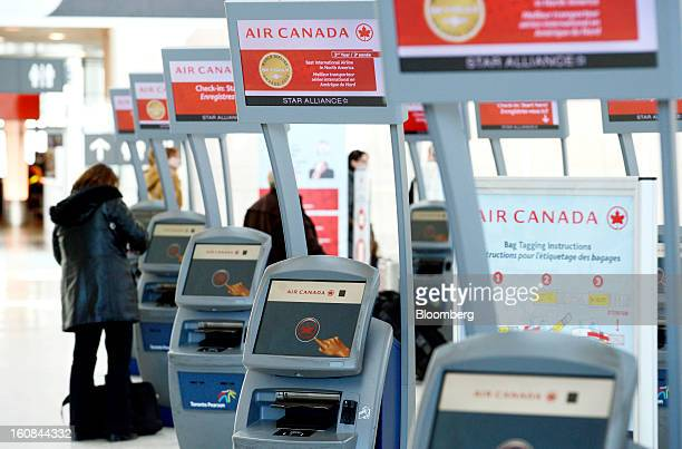 A traveler uses an Air Canada checkin kiosk at Pearson International Airport in Toronto Ontario Canada on Wednesday Feb 6 2013 Air Canada the...