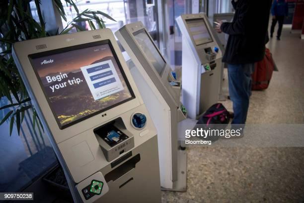 A traveler uses an Alaska Air Group Inc self checkin kiosk at the Oakland International Airport in Oakland California US on Friday Jan 19 2018 Alaska...