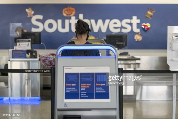 Traveler uses an automated check-in kiosk at a Southwest Airlines Co. Check-in area at Oakland International Airport in Oakland, California, U.S., on...