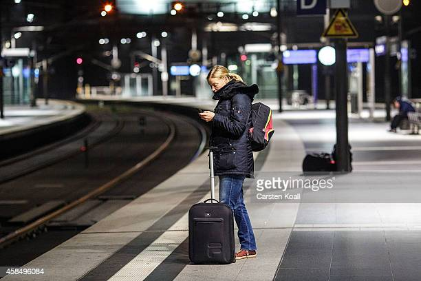 A traveler waits for one of the few running trains on a platform at Hauptbahnhof main railway station during a fourday strike by the GDL train...