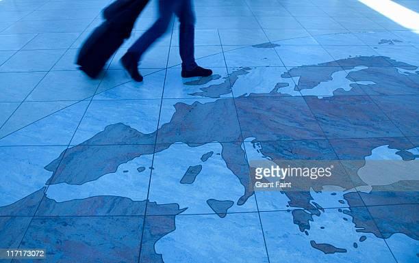 Traveler walking on Europe map floor