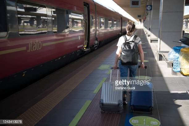 A traveler walks luggage to the interregional train at the Porta Nuova railway station on June 03 2020 in Turin Italy Today 3 June the Italian...