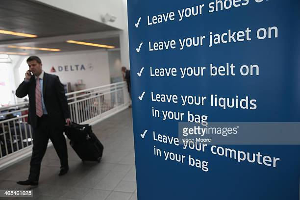 A traveler walks past a newlyopened TSA Precheck application center at LaGuardia Airport on January 27 2014 in New York City Once approved travelers...
