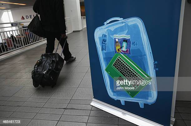 A traveler walks past a newlyopened TSA Precheck application center at Terminal C of the LaGuardia Airport on January 27 2014 in New York City Once...