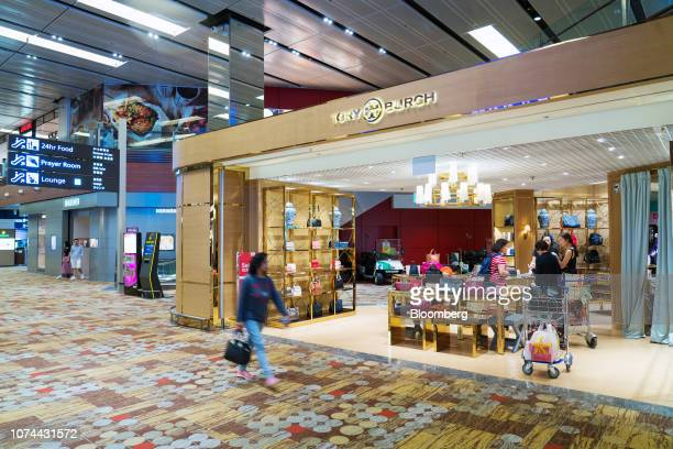 A traveler walks past a Tory Burch LLC store at Terminal 1 of Changi Airport in Singapore on Thursday Dec 13 2018 Singapore'sChangiAirport...