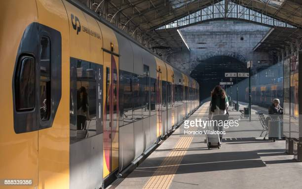 A traveler walks the platform to board a local train at Sao Bento train station during the visit to the premises by participants of Gastronomic FAM...