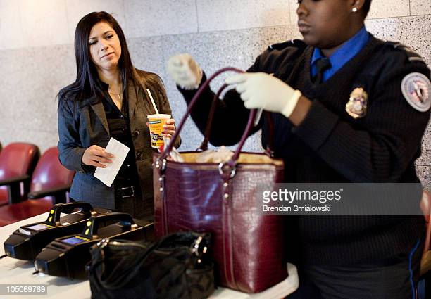 A traveler watches as a Transportation Security Administration Agent screens her bag during 'Operation Railsafe' at Union Station October 8 2010 in...