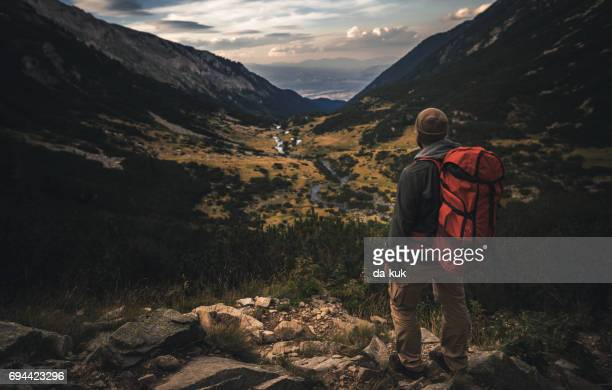 traveler watching the sunset over the mountains - pirin national park stock pictures, royalty-free photos & images