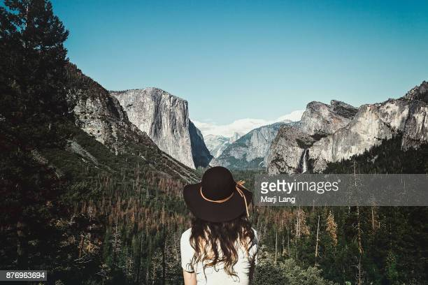 Traveler watching the Tunnel View of Yosemite National Park with El Capitan Half Dome and Bridalveil Fall Yosemite National Park California United...