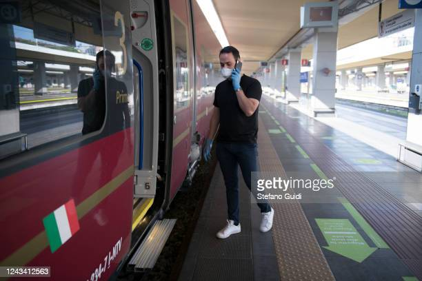 A traveler wearing a protective mask enters the train at the Porta Nuova railway station on June 03 2020 in Turin Italy Today 3 June the Italian...