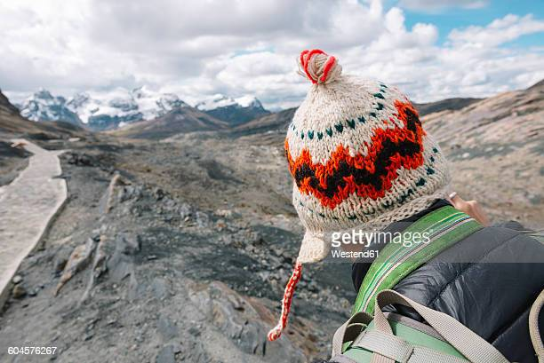 Traveler wearing a wool chullo in the Cordillera Blanca, part of the Andes mountain range