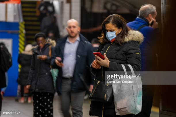 A traveler wears a medical mask at Grand Central station on March 5 2020 in New York City Six people have been infected with the COVID19 virus in New...