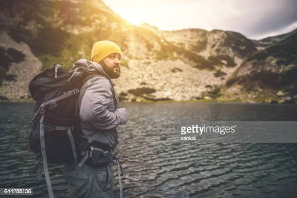 traveler with a backpack looking at the camera - pirin national park stock pictures, royalty-free photos & images