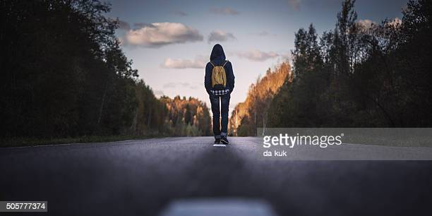 Traveler with backpack walking forward