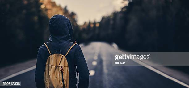traveler with backpack walking forward - stranger stock photos and pictures