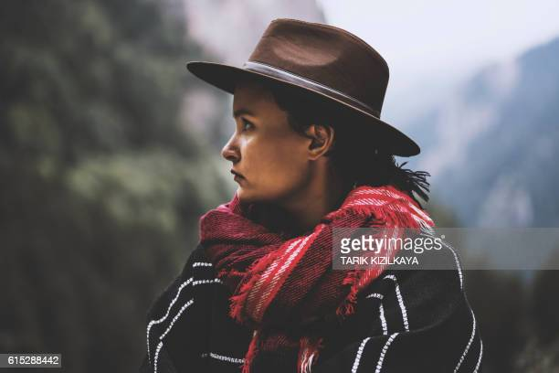 Traveler with cowboy hat and red scarf