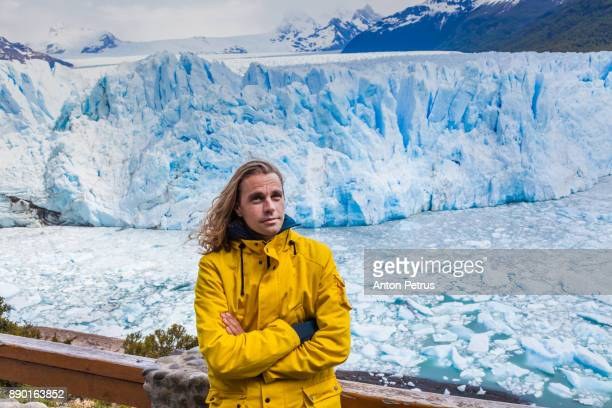 Traveler with long hair on the background of the Perito Moreno glacier