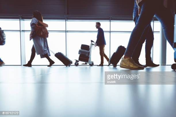 Traveler with luggage cart at the international airport