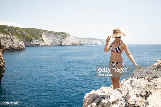 traveler woman enjoying the view with the beautiful coastline of greece. - hot babes stock pictures, royalty-free photos & images