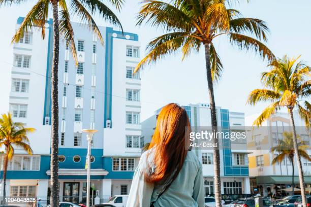 traveler woman in the famous ocean driver of miami beach. - miami beach stock pictures, royalty-free photos & images