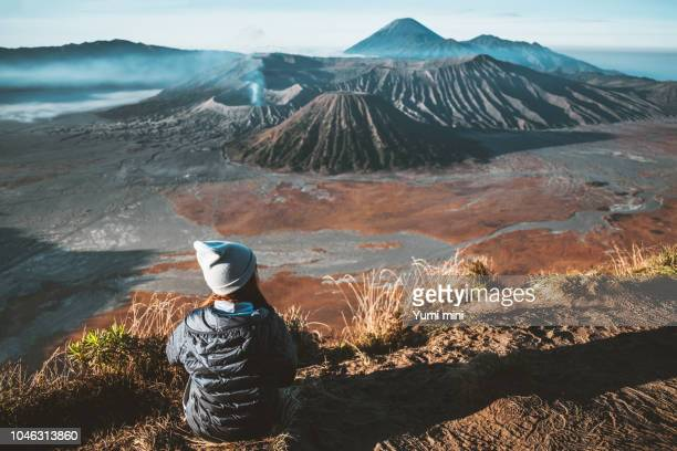 traveler women and sunrise at volcano mt.bromo (gunung bromo) kingkong hill east java,indonesia - mount bromo stock pictures, royalty-free photos & images
