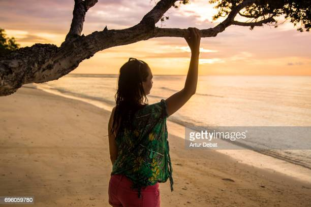 traveler women enjoying sunset moment on the beach with beautiful colors during travel vacations in indonesia. - gili trawangan stock photos and pictures