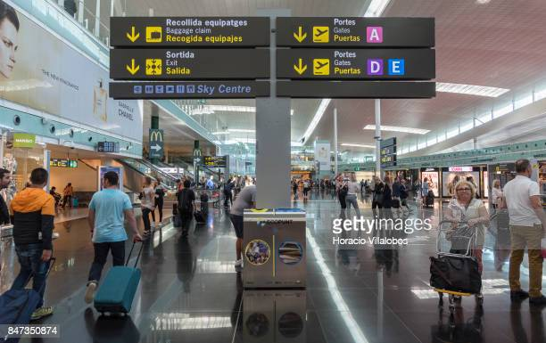 Travelers and information signs are seen at departures main hall of Terminal 1 of Barcelona El Prat Airport on September 10 2017 in Barcelona Spain...