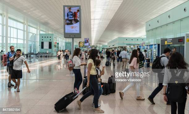 Travelers and information signs are seen in Terminal 1 of Barcelona El Prat Airport on September 05 2017 in Barcelona Spain Barcelona El Prat Airport...