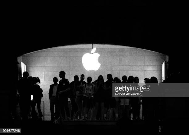 Travelers and tourists are silouetted in front of the Apple Store logo in the Main Concourse at Grand Central Terminal in New York City