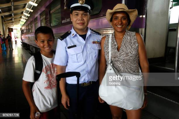 Travelers and train manager in Chiang Mai railway station Thailand