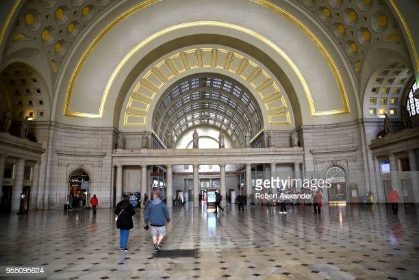 Travelers and visitors walk through Union Station in Washington, D.C. Union Station is a major Amtrak train station, transportation hub and leisure...