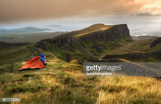 Travelers are camping tent at Quiraing, Isle of Skye, UK.