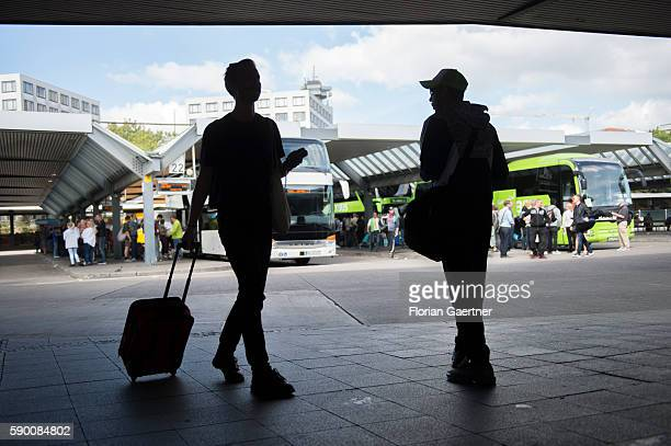 Travelers are captured in front of a longdistance bus station on August 16 2016 in Berlin Germany