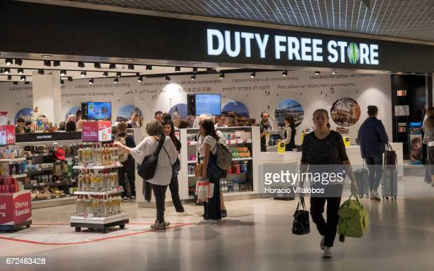 Travelers are seen at the Duty Free Store of Humberto Delgado Airport on April 23 2017 in Lisbon Portugal The airport is the main international...