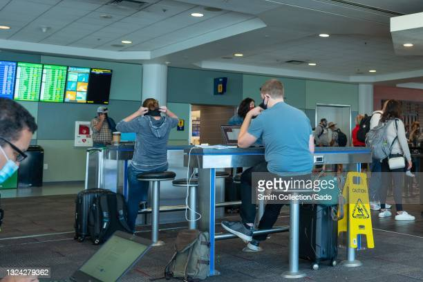 Travelers are visible at a Southwest Airlines waiting area at Oakland International Airport, Oakland, California, May 28, 2021.