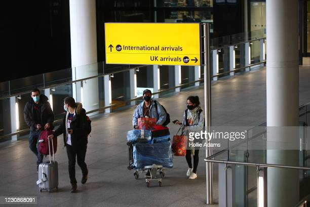 """Travelers arrive at Heathrow Terminal 2 on January 30, 2021 in London, England. The UK government has added flights from the UAE to the """"red list"""" of..."""