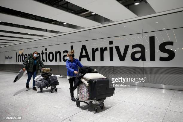 """Travelers arrive at Heathrow Terminal 5 on January 30, 2021 in London, England. The UK government has added flights from the UAE to the """"red list"""" of..."""