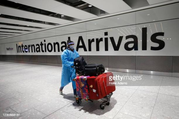 "Travelers arrive at Heathrow Terminal 5 on January 30, 2021 in London, England. The UK government has added flights from the UAE to the ""red list"" of..."