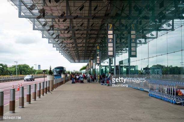 Travelers arrive at Terminal 3 of Changi Airport in Singapore on Thursday Dec 13 2018 Singapore'sChangiAirport votedtheworld's bestfor the past...