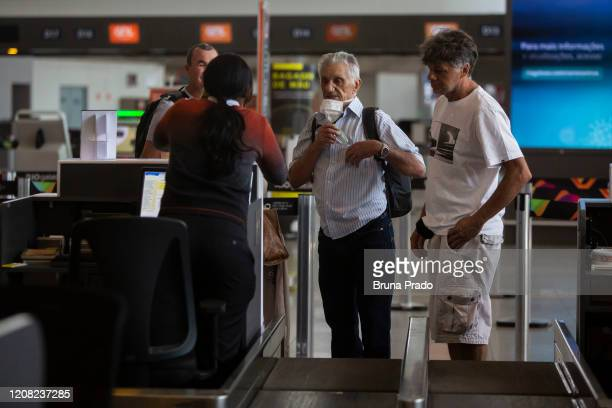 Travelers arrive at the check in desk of the Tom Jobim International Airport on March 25 2020 in Rio de Janeiro Brazil The federal government have...