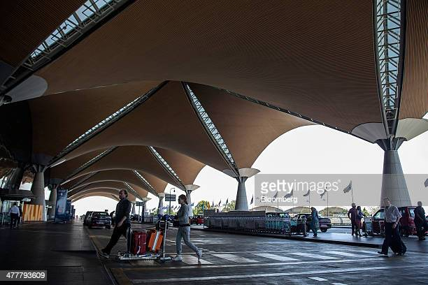 Travelers arrive at the departures hall at Kuala Lumpur International Airport in Sepang Malaysia on Tuesday March 11 2014 The probe into the...