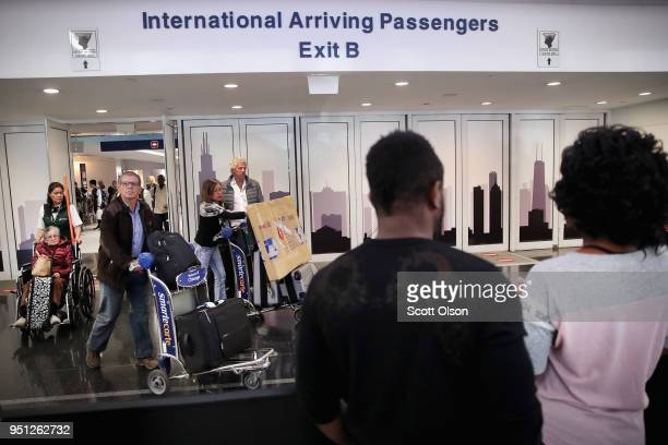 Travelers arrive at the international terminal of O'Hare International Airport on April 25 2018 in Chicago Illinois The US Supreme Court today began...